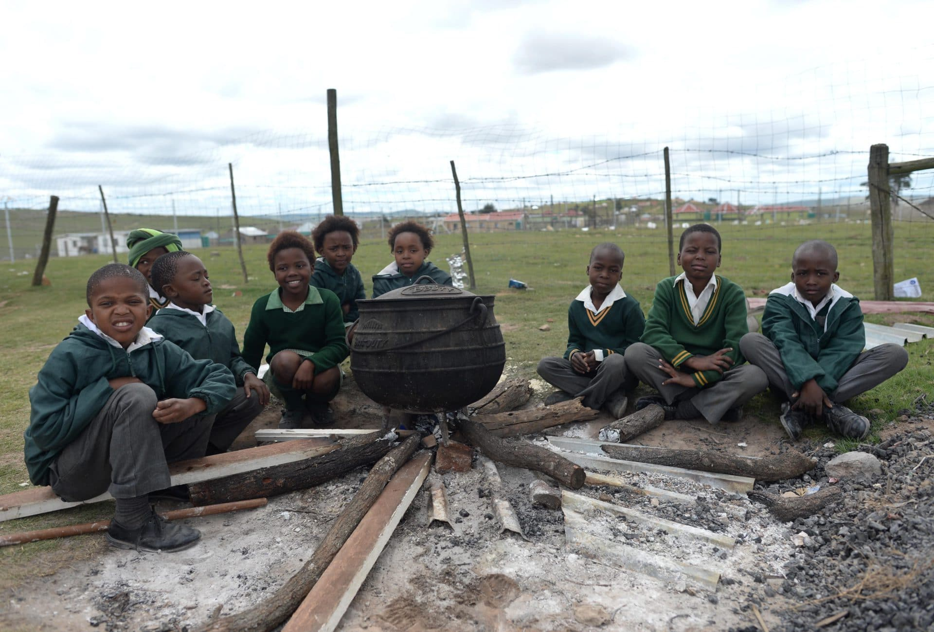School children cooking pot